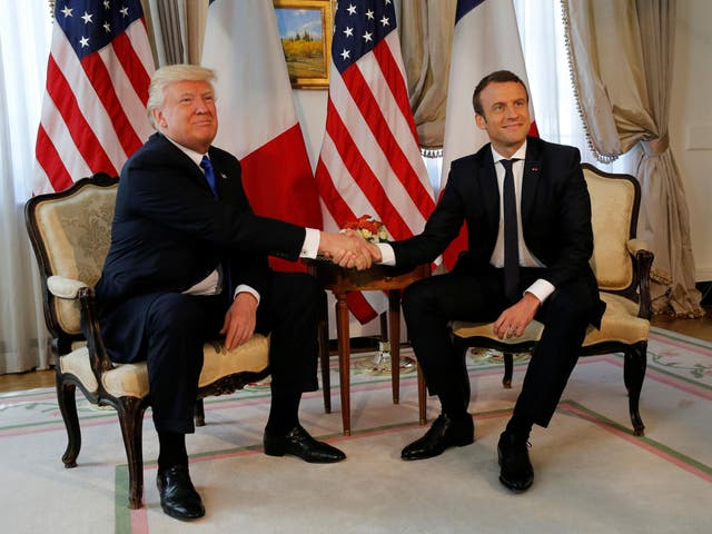 US President Donald Trump and French President Emmanuel Macron shake hands before a lunch ahead of a Nato Summit in Brussels