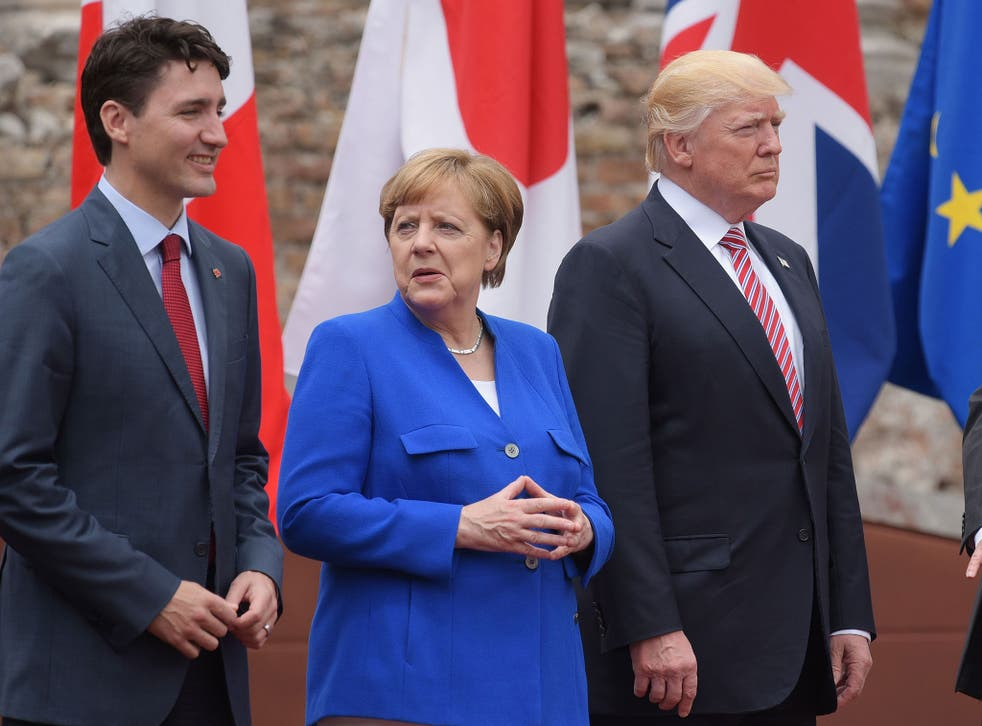 Canada's Prime Minister Justin Trudeau, Germany's Chancellor Angela Merkel and Donald Trump during the G7 Summit in Taormina