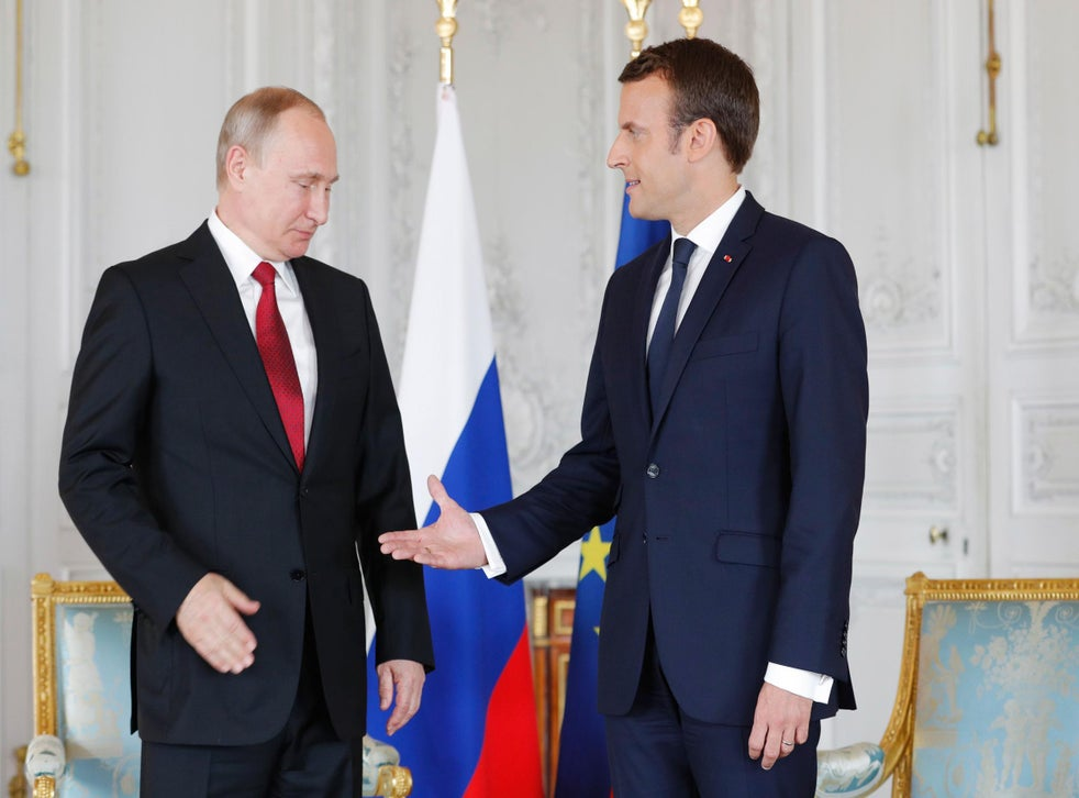 Vladimir Putin And Emmanuel Macron Appear Awkward As They Shake Hands In First Meeting In Versailles The Independent The Independent