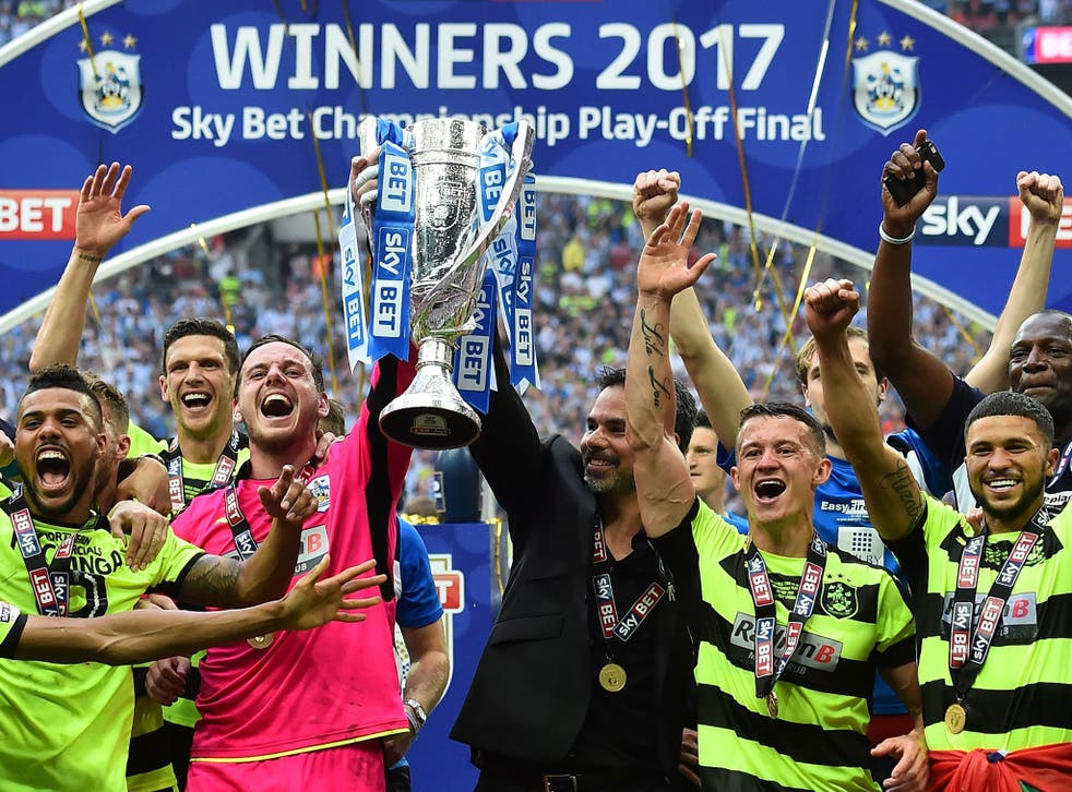 Huddersfield lift the trophy after beating Reading on penalties