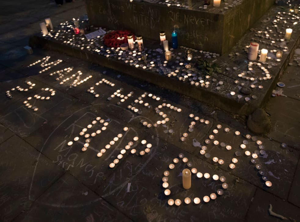Memorial candles are seen during a vigil on St Ann's Square in Manchester after the attack