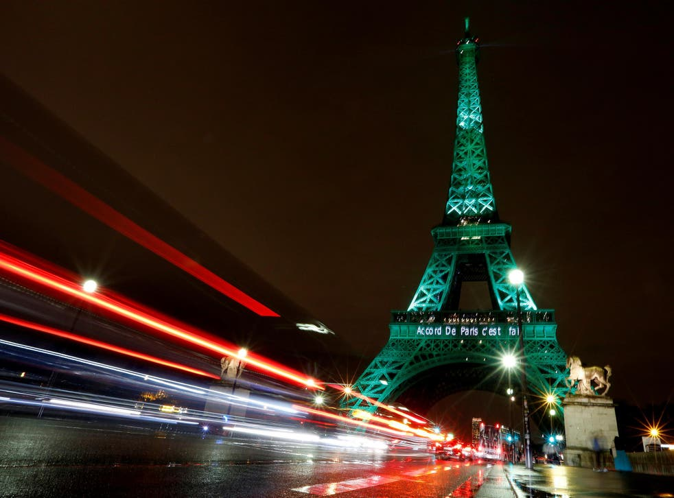 The Eiffel tower is illuminated in green with the words 'Paris Agreement is Done' to celebrate the Paris UN COP21 Climate Change agreement on 4 November 2016