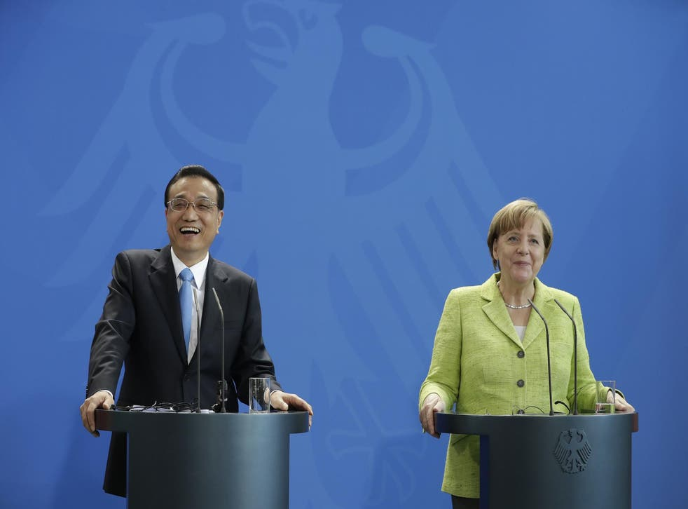 German Chancellor Angela Merkel and China's Premier Li Keqiang address the media during a joint press conference