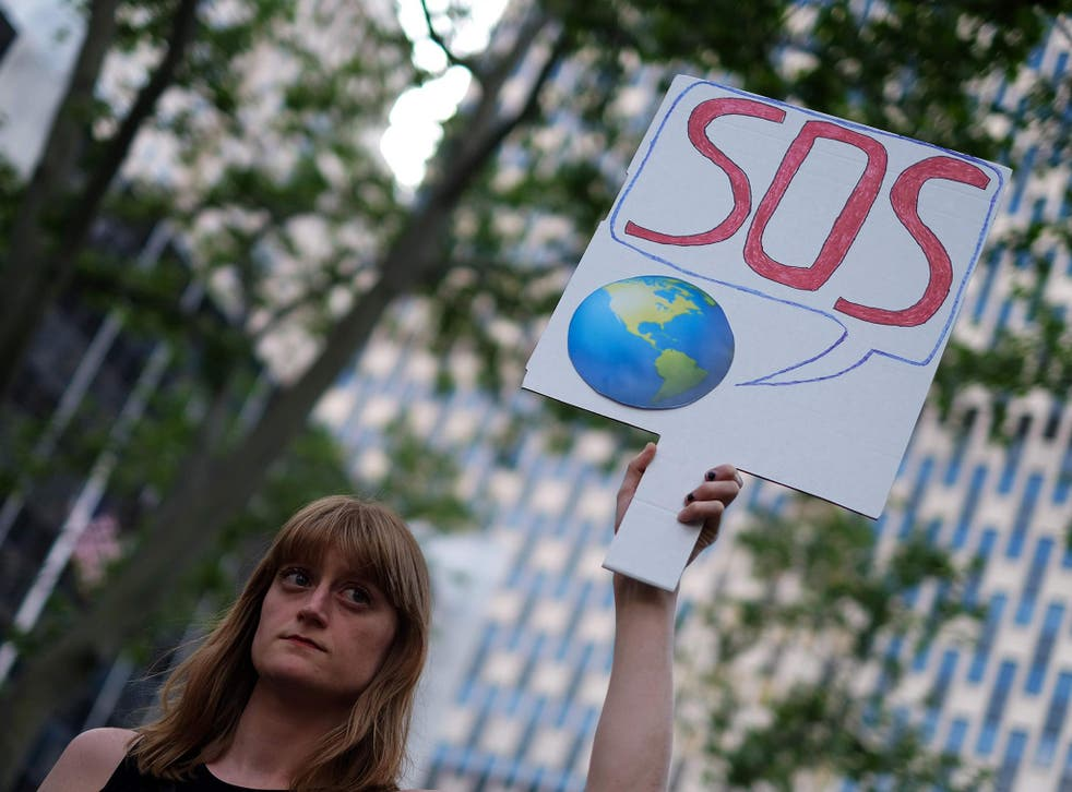 A woman displays a placard during a demonstration in New York on June 1, 2017