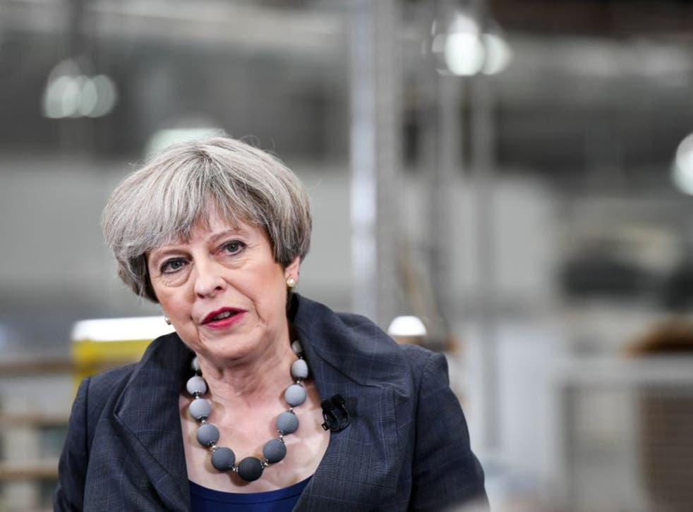 Theresa May speaks to workers during a general-election campaign tour stop at Ultima Furniture Systems Ltd. in Pontefract