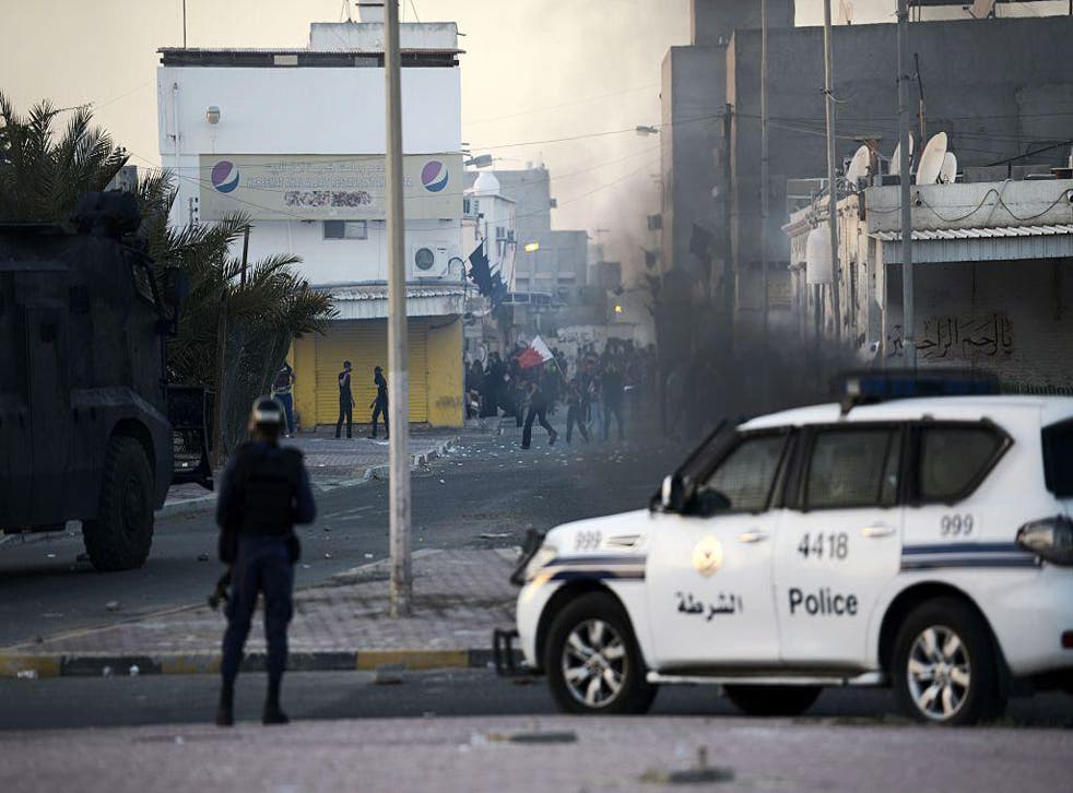 Protesters throw stones towards riot police during clashes in the Shiite village of Shahrakkan, south of Manama, in this file photo from 5 April 2016