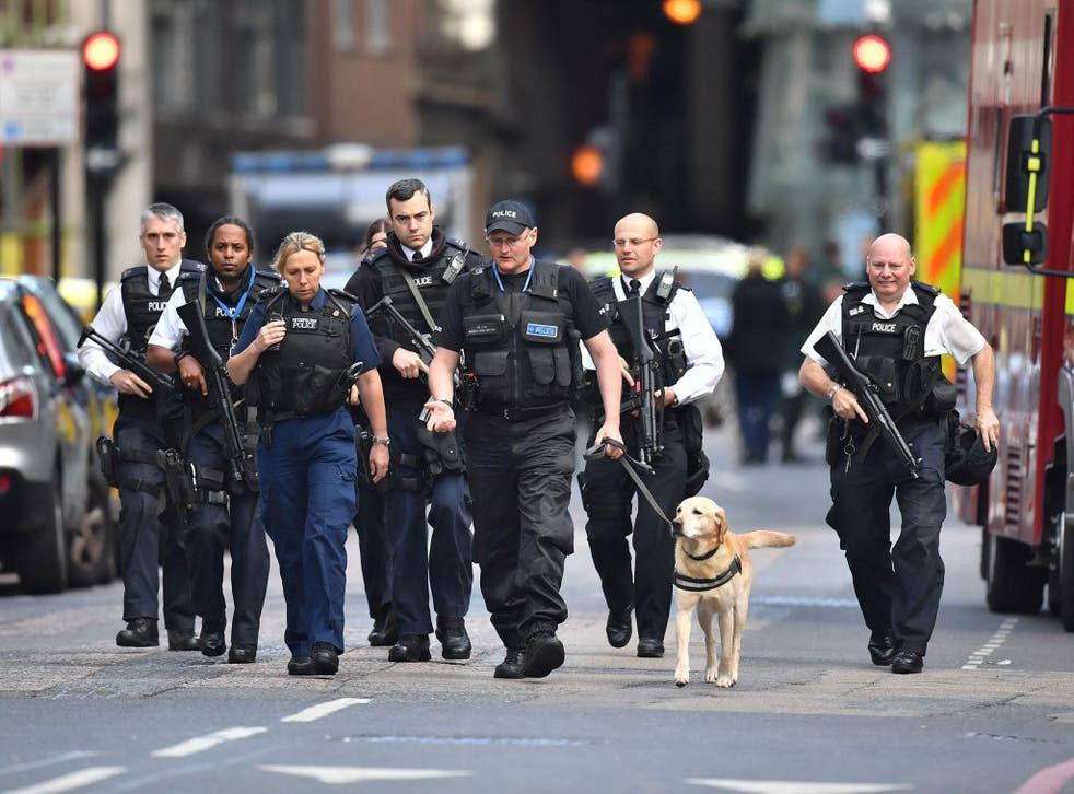 Armed police on St Thomas Street, London, near the scene of last night's terrorist attack at Borough Market