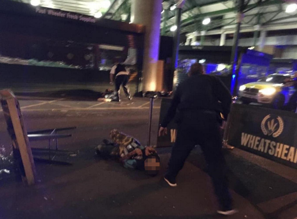 Image shows two men lying on the ground after having reportedly been shot by the police in what is believed to be linked to terrorist attacks in the centre of London