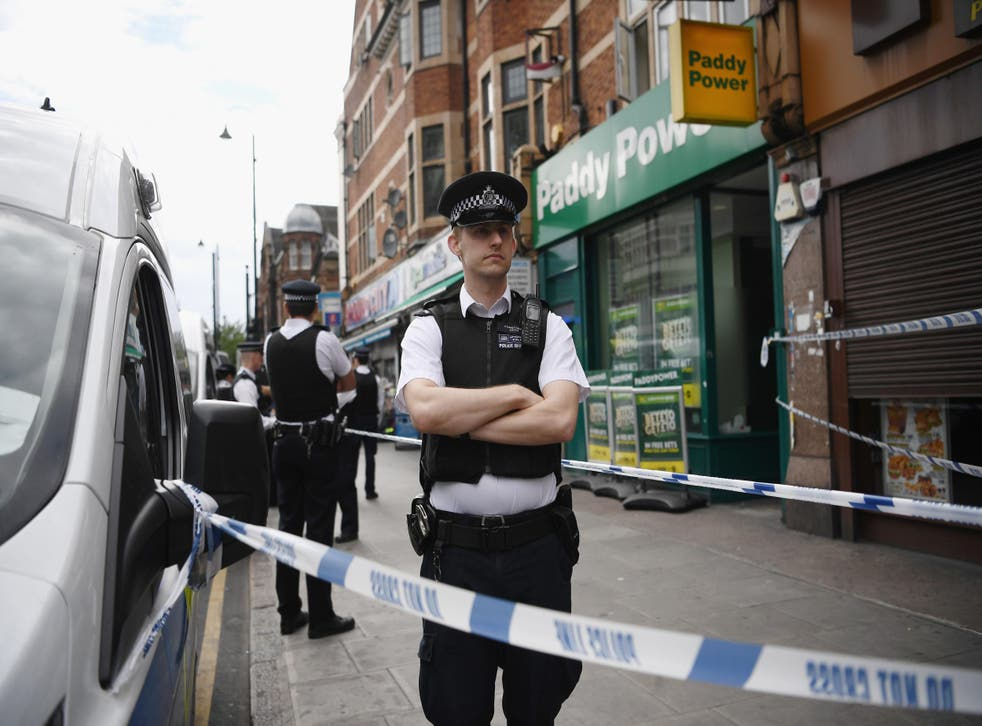 Police outside a property in East Ham which has been raided by officers