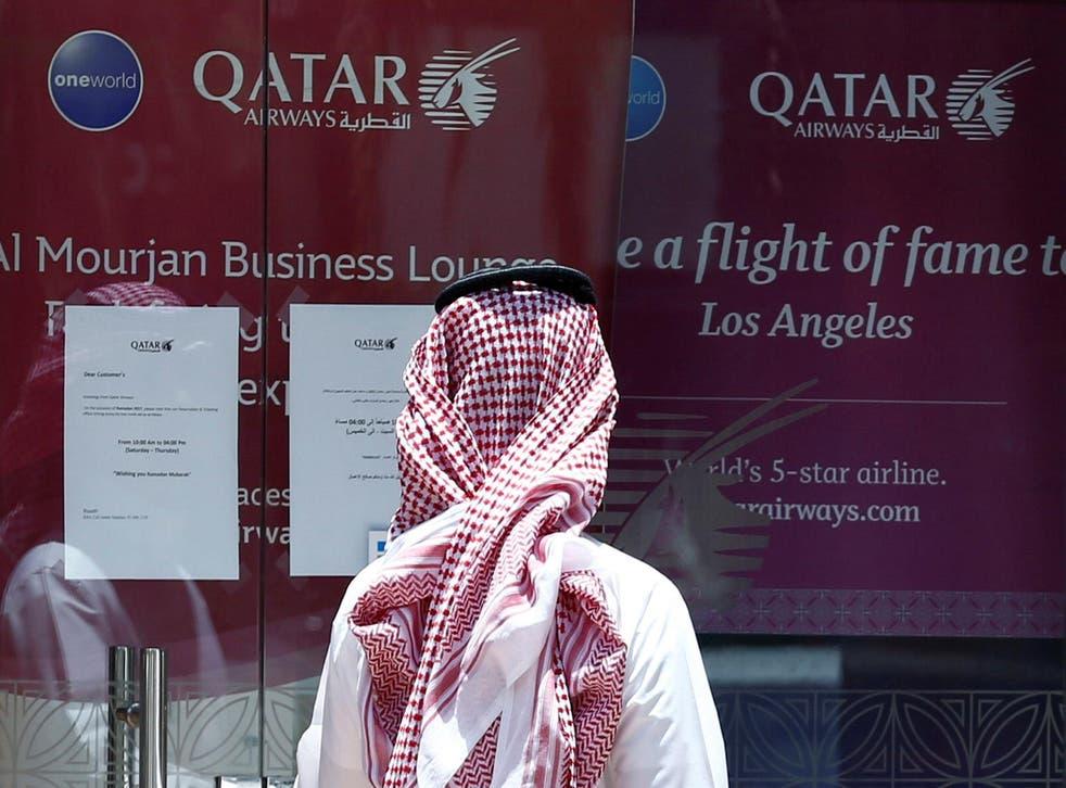 A man stands outside a Qatar Airways office in Riyadh, Saudi Arabia on 5 June 2017