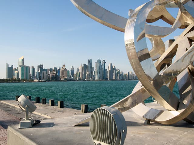 Buildings are seen from across the water in Doha, Qatar