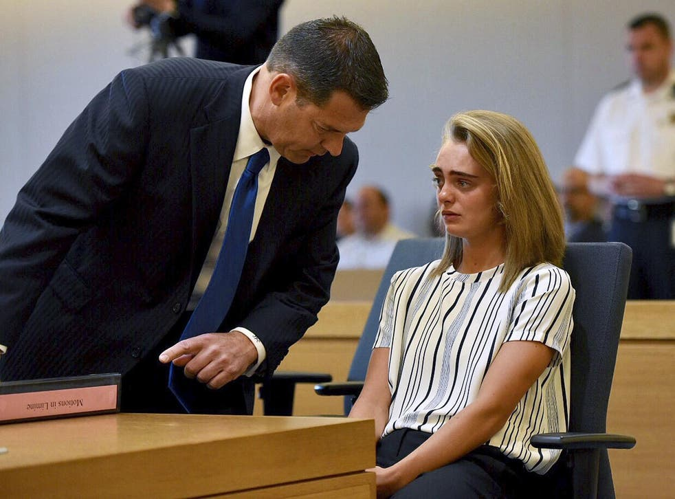 Defence lawyer Joseph Cataldo talks to his client, Michelle Carter, at the beginning of Monday's session at Taunton Juvenile Court in Massachusetts