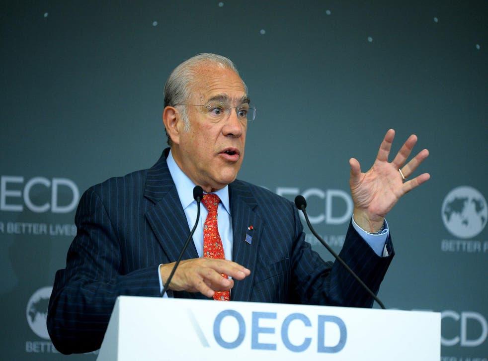 OECD General Secretary Angel Gurria unveils its latest Global Economic Outlook in Paris