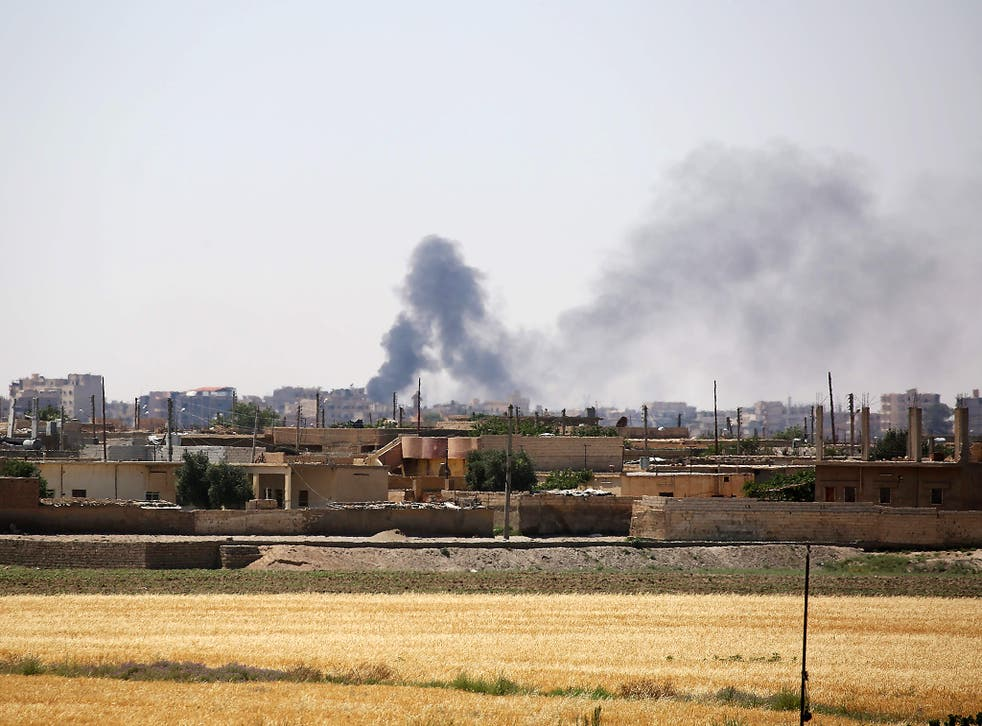 Smoke rises from buildings in the al-Meshleb neighbourhood of Raqa as the Syrian Democratic Forces (SDF), made up of an alliance of Kurdish and Arab fighters, try to advance further into the Islamic State (IS) group's Syrian bastion