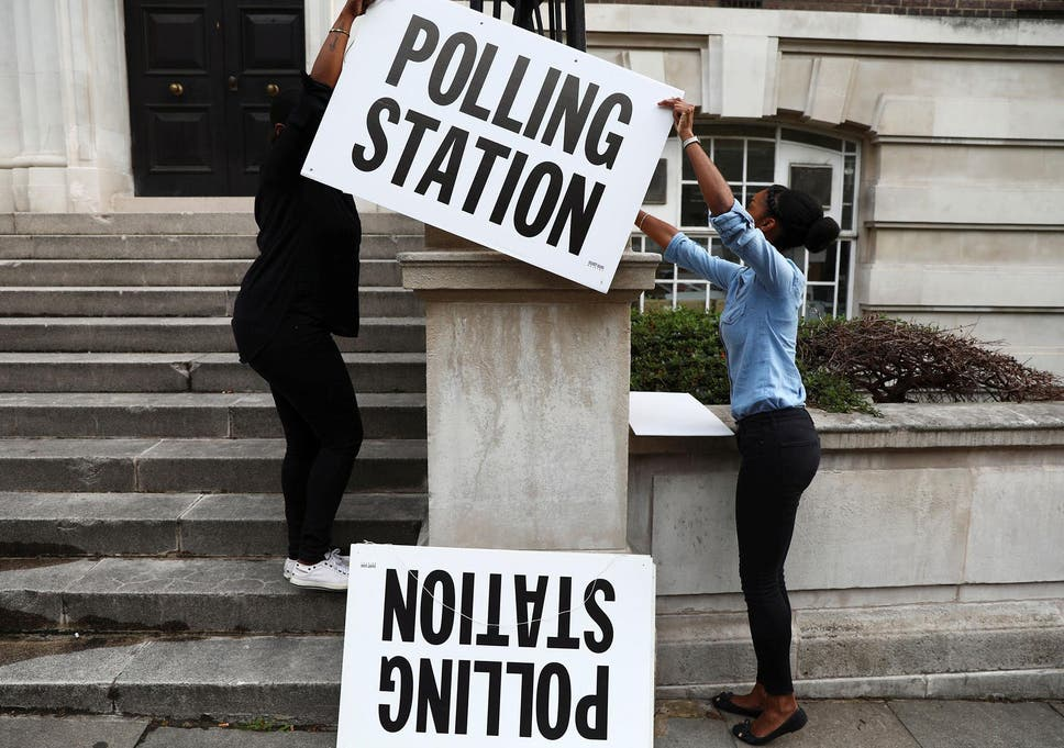51fe3932a68ed Workers prepare signs outside their polling station on general election day  in London on 8 June