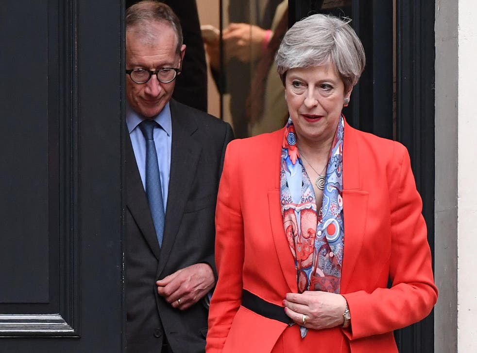 Theresa May leaving Conservative Party HQ with her husband Philip after admitting to activists that it had been a 'difficult' night