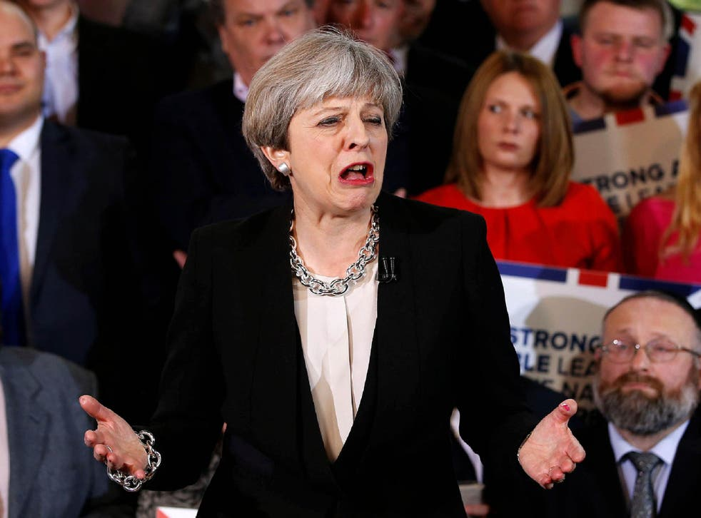 Theresa May delivers a speech to Conservative Party members as they launch their election campaign in Walmsley Parish Hall in Bolton in north-western Greater Manchester