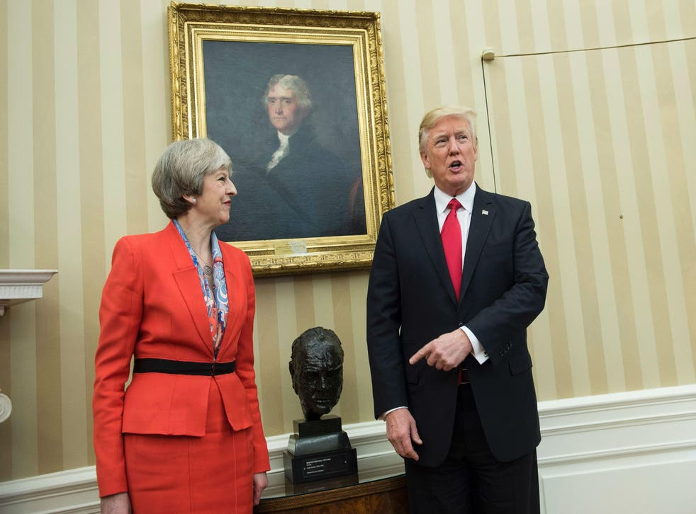 Theresa May and Donald Trump meet beside a bust of former British Prime Minister Winston Churchill in the Oval Office of the White House on January 27, 2017