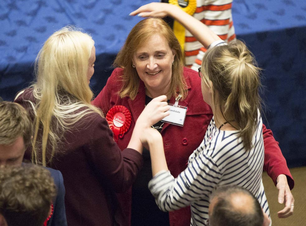 Labour's Emma Dent Coad is congratulated after she was elected as MP for Kensington