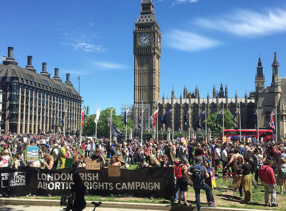 Protesters gather in Westminster, central London to voice their anger at Theresa May's government and her alliance with the Democratic Unionist Party