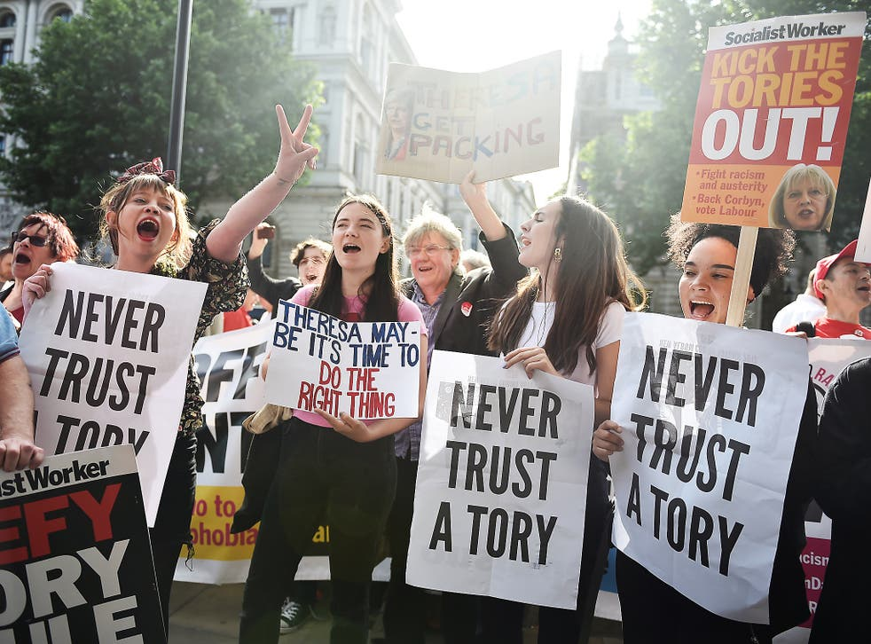 Hundreds marched in London today to protest against the formation of a coalition between the two parties