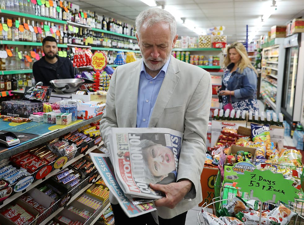 Labour Jeremy Corbyn looks at newspapers following the general election