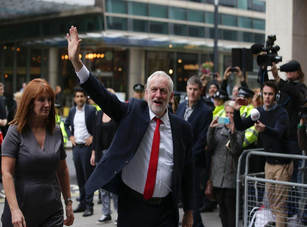 Labour Party Leader Jeremy Corbyn waves as he arrives at Labour Party headquarters in central London after the results of a recent snap election