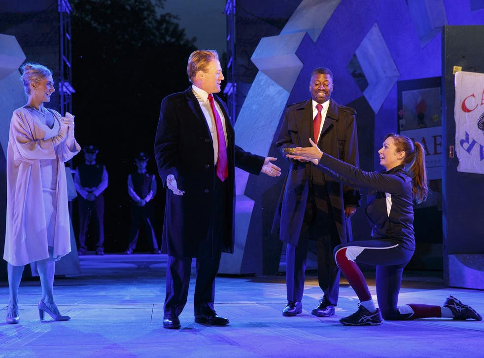 Tina Benko, left, portrays Melania Trump in the role of Caesar's wife, Calpurnia, and Gregg Henry, centre left, portrays President Donald Trump in the role of Julius Caesar during a dress rehearsal of The Public Theater's Free Shakespeare in the Park production in New York