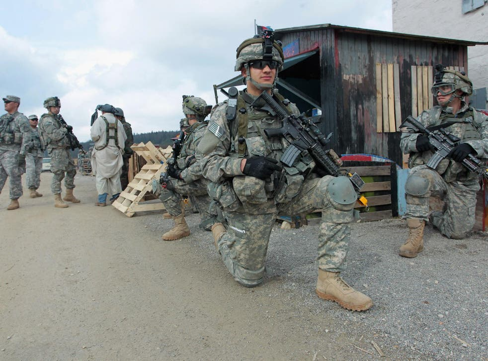 US soldiers of the 173rd Airborne Brigade based in Vicenza, Italy, conduct a patrol through a mock Afghan village during a training exercise at the US Army's Joint Multinational Readiness Center