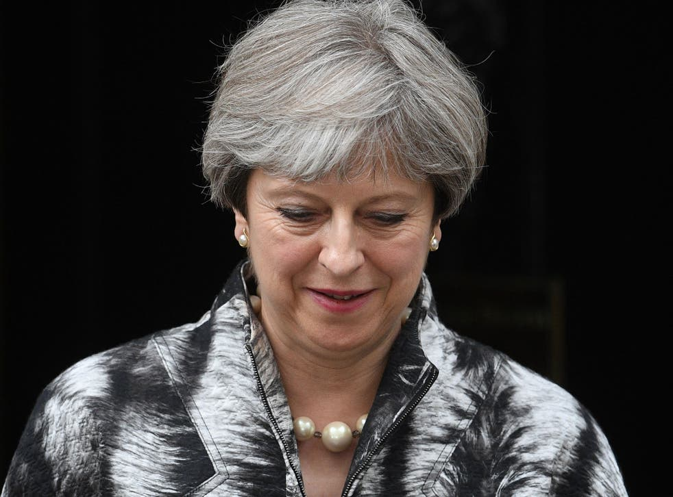 Theresa May leaves Downing Street on the way to a meeting of the Conservative Party's 1922 Committee