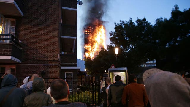 Local residents watch as Grenfell Tower is engulfed by fire