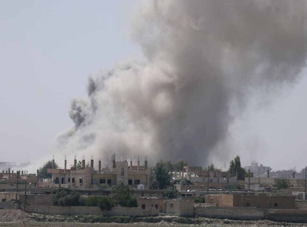 Smoke rises from the al-Mishlab district at Raqqa's southeastern outskirts on 7 June