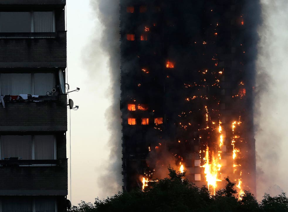 Smoke and flames rise from Grenfell Tower in west London