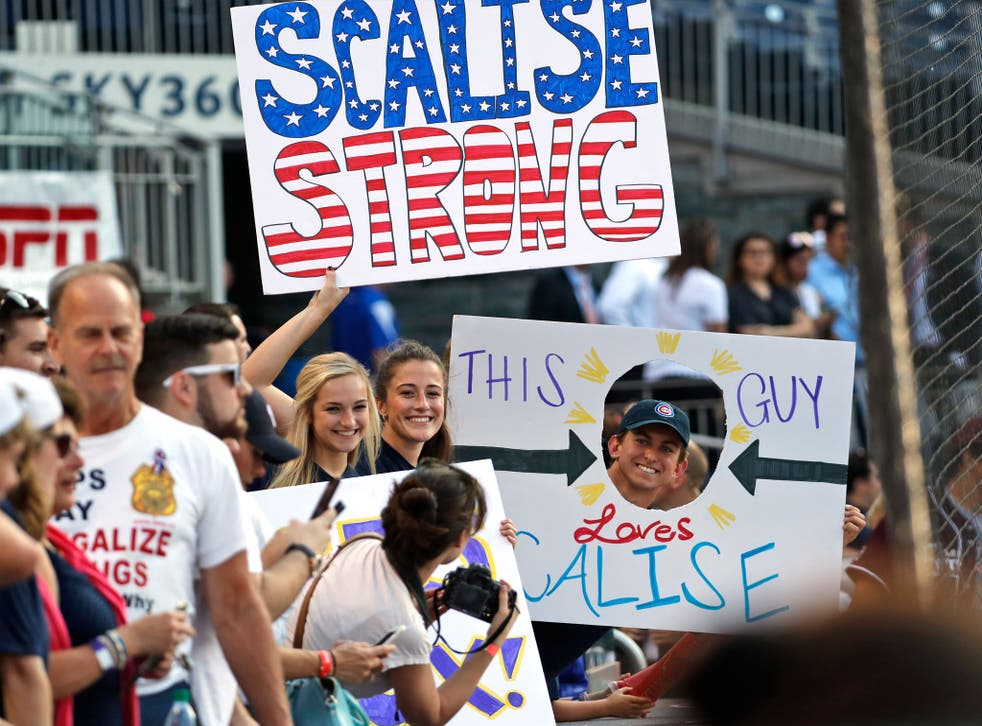 Supporters of Steve Scalise hold signs before the annual baseball game