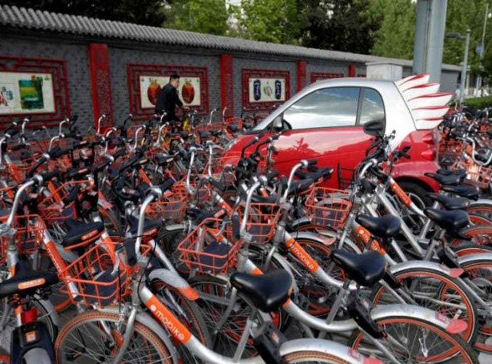 The GPS-tracked bikes, which are distinguished by their orange wheels, can be locked and unlocked anywhere using a smartphone app