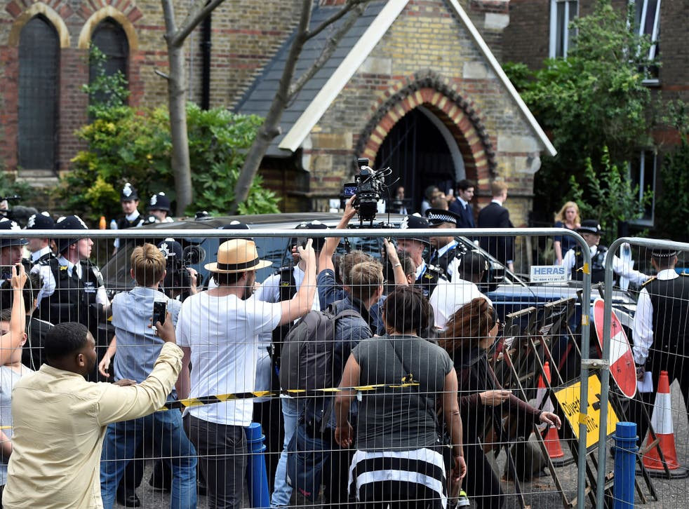 Theresa May announced the measures while visiting fire survivors at a church in Kensington