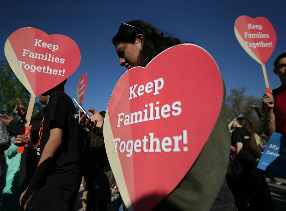 Pro-immigration activists hold signs as they gather in front of the US Supreme Court on 18 April 2016 in Washington, DC