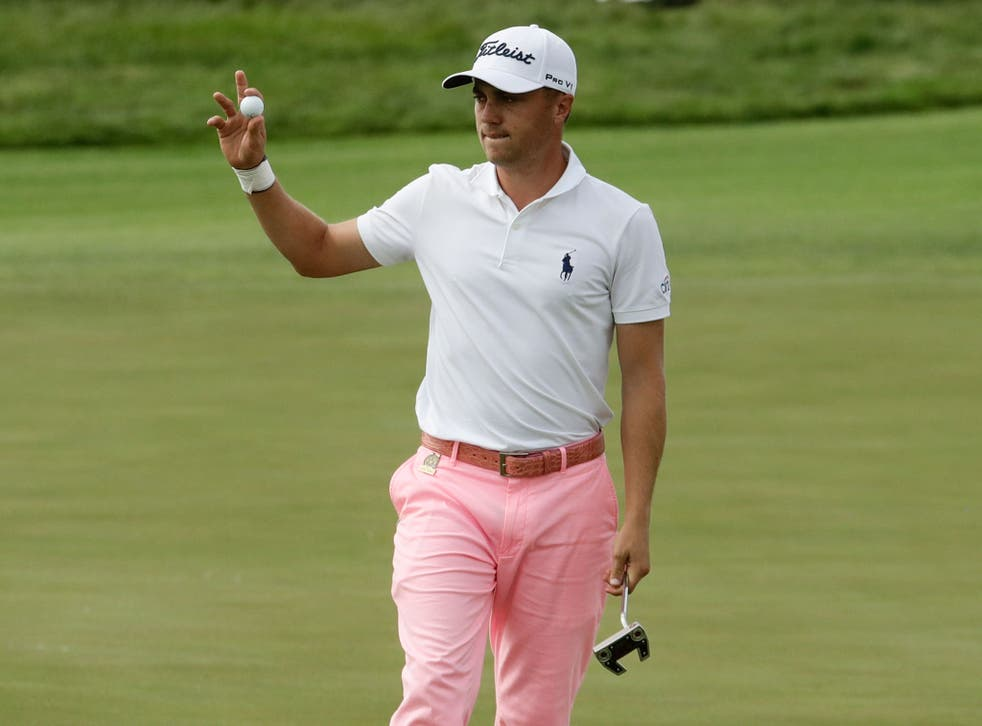 Justin Thomas reacts after his birdie on the 17th hole during the third round of the U.S. Open golf tournament Saturday, June 17, 2017, at Erin Hills
