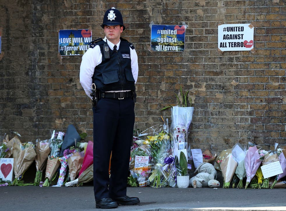 Tributes and flowers at a police cordon in Finsbury Park following a vehicle attack on pedestrians