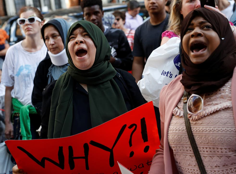 Demonstrators outside Kensington Town Hall during a protest following the fire that destroyed the Grenfell Tower block