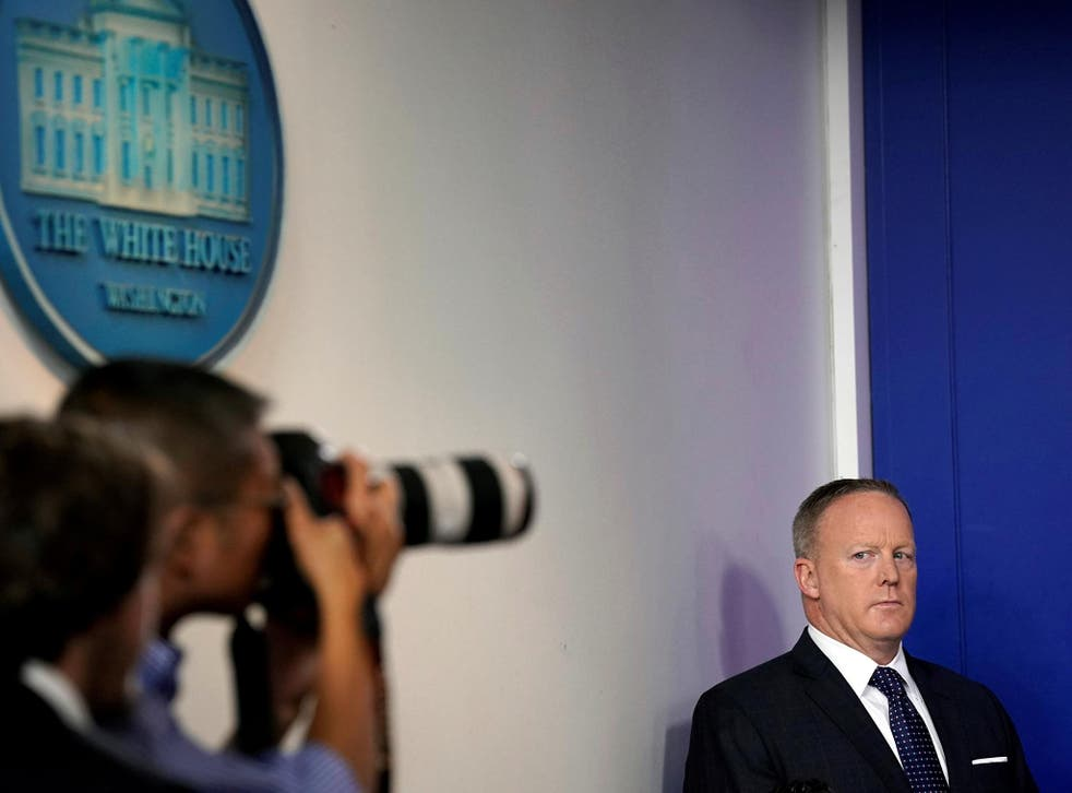 White House Press Secretary Sean Spicer looks at a photographer during the daily briefing