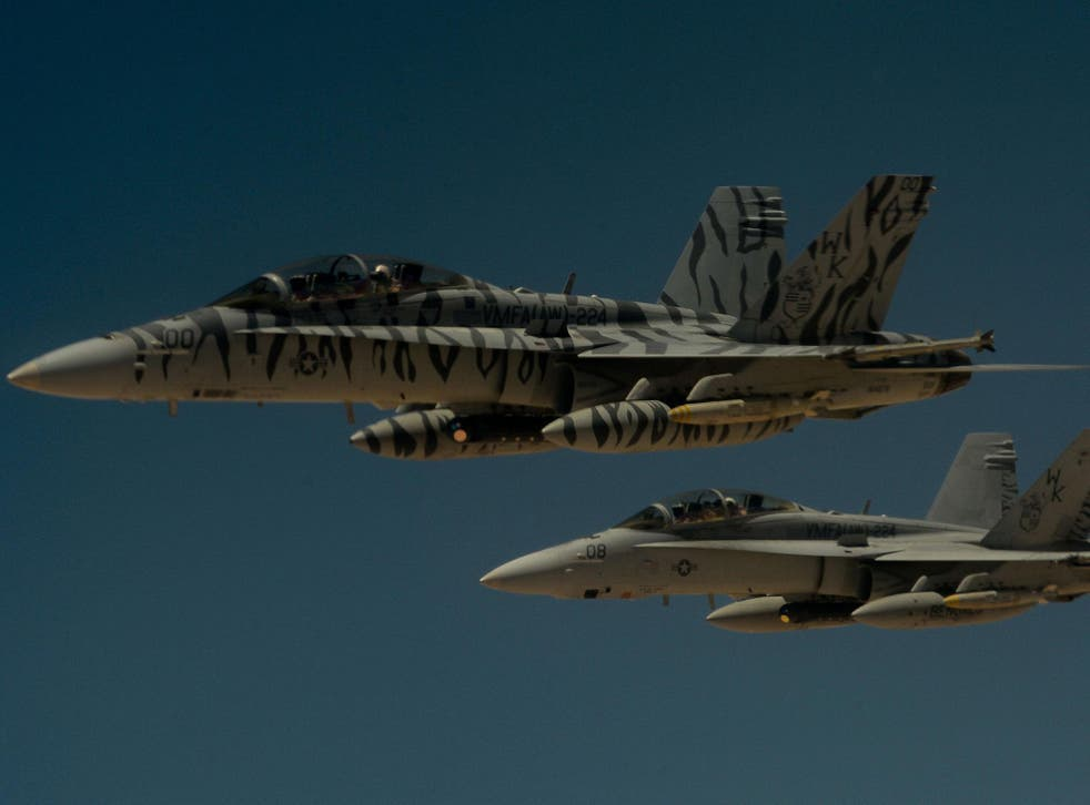 Warning: Moscow believes US jets such as these F18s are in breach of international law in engaging Syrian targets