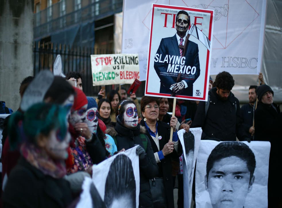 Protesters take part in a demonstration against alleged corruption and violations of human rights by Enrique Pena Nieto, the President of Mexico, on March 3, 2015 in London