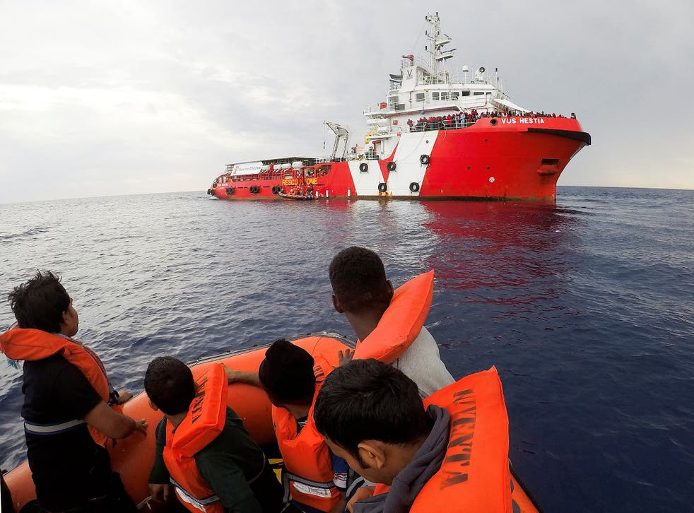 Migrants rescued by Save the Children's crew approach the ship Vos Hestia in the Mediterranean off Libya's coast