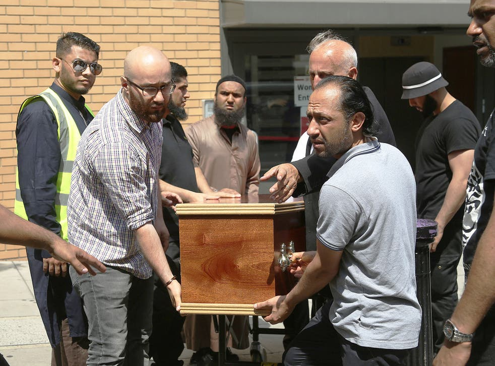 The coffin of Mohammad Alhajali, a victim of the deadly Grenfell Tower blaze, is taken from the east London Mosque in Whitechapel, for his burial.