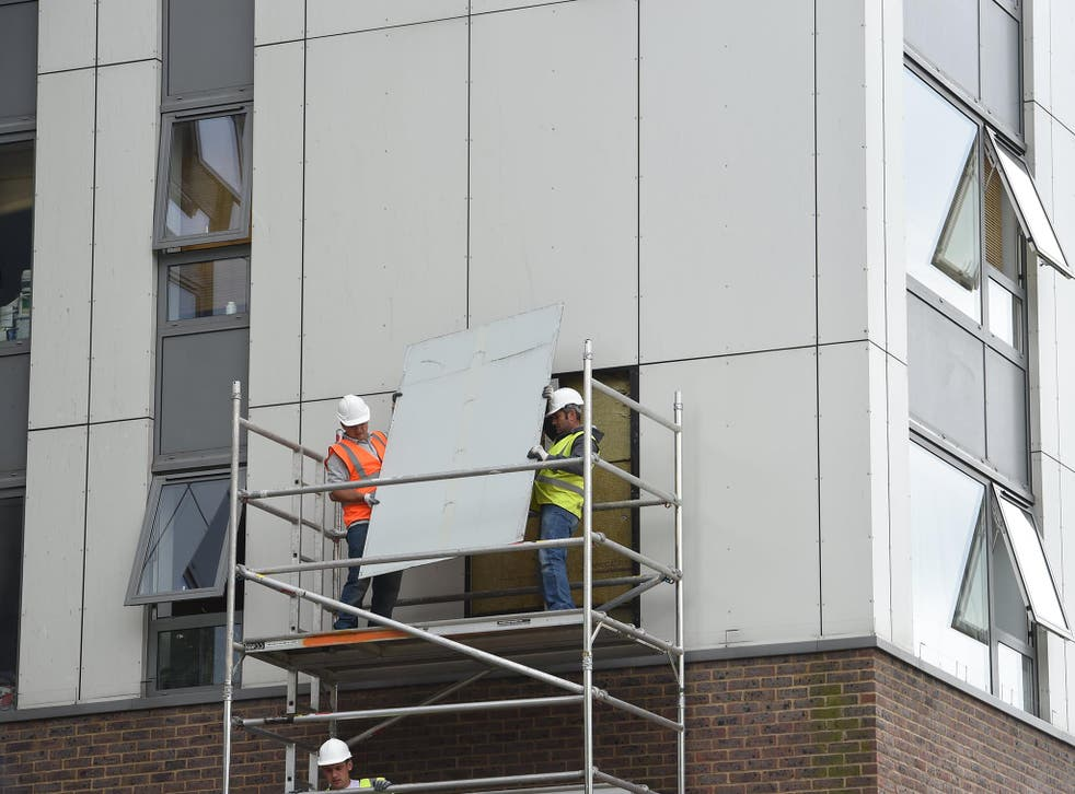 A portion of cladding is removed from a block in Camden