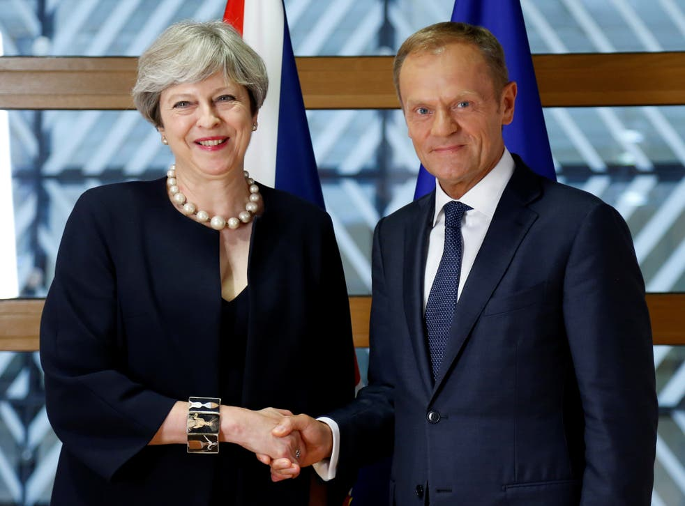 Prime Minister Theresa May and European Council President Donald Tusk pose during an EU leaders summit in Brussels