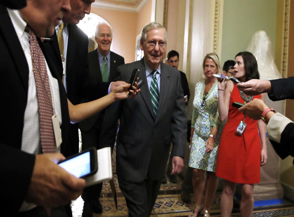Senate Majority Leader Mitch McConnell, followed by Majority Whip John Cornyn