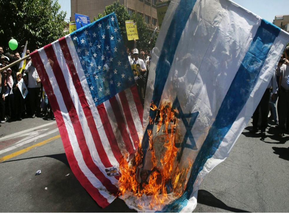 Demonstrators burn Israeli and American flags in Tehran on Al-Quds Day, an annual display of support for Palestinians against Israel and of the importance of the city of Jerusalem to Muslims, on 23 June 2017