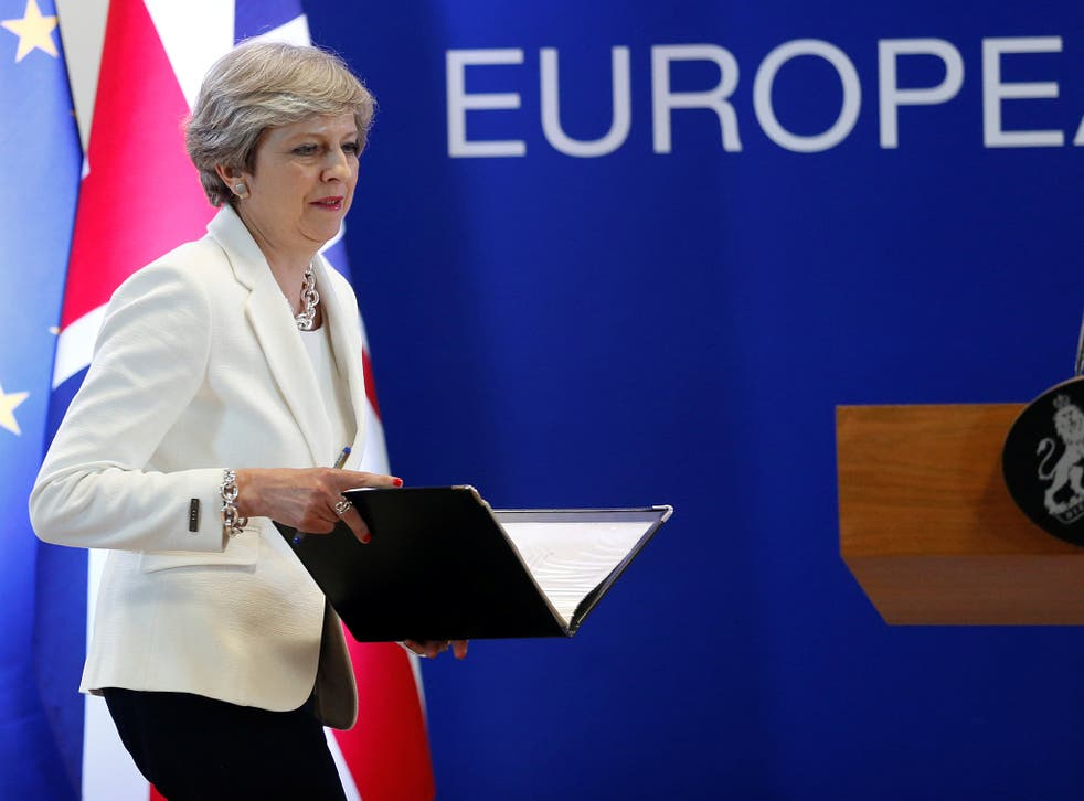 Theresa May arrives at a news conference at the EU summit in Brussels